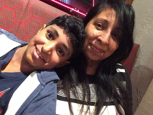 Karan (pictured with his mother Rina) had been bullied at school, a family friend has said