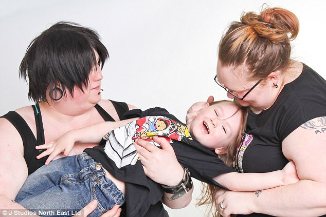 Nikki (right) and Louise Draven (left) with their son Star, four, who they are raising not to be