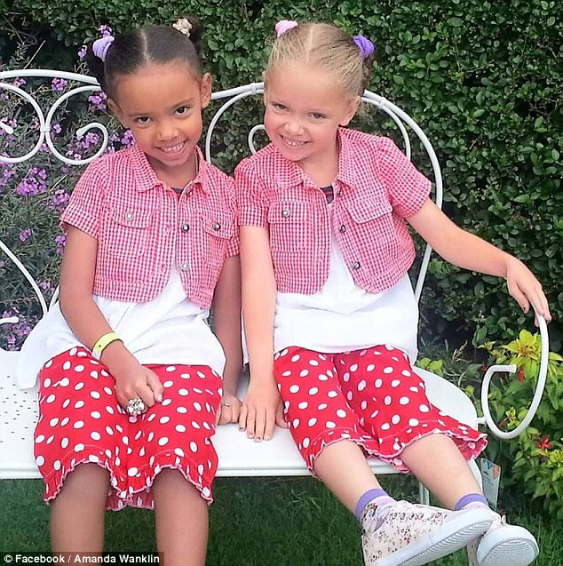 Millie, left, has dark skin, brown eyes, and black hair takes after her Jamaican-descent father while Marcia, right, has fair skin, blue eyes, and blonde hair takes after her Caucasian mother