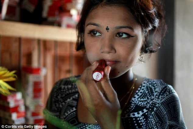Underage sex worker Bristi applying heavy makeup to appear more mature for her evening clients at Bangladesh