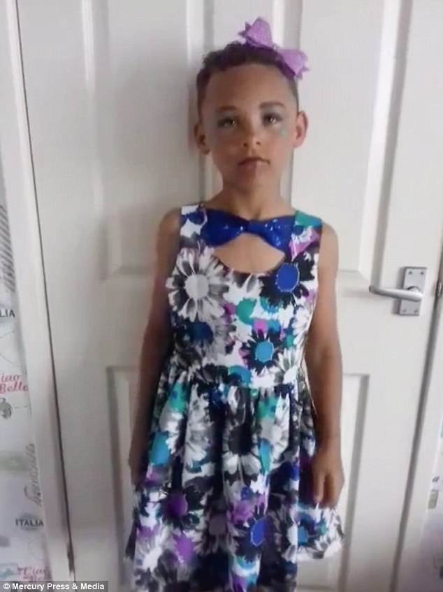 Eight-year-old Fabian Butler, from Gwent, dressing up at home. The youngster loves wearing women
