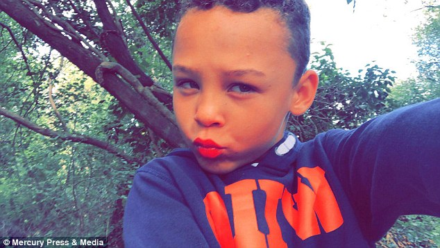Eight-year-old Fabian Butler, from Gwent (pictured with makeup) loves wearing women