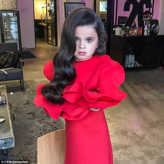 One snap sees Mia posing in a red dress with her hair blow-dried into side-parted Hollywood waves, racking up thousands of likes and comments on how much hair she has