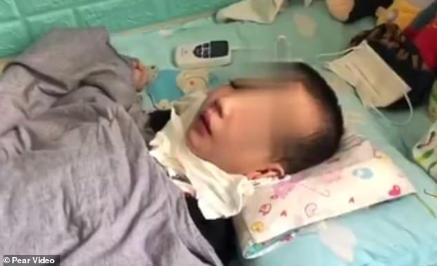 A woman in north-west China was sentenced to 16 years in prison for physically abusing her six-year-old stepson Peng Peng (pictured) leaving him in a vegetative state