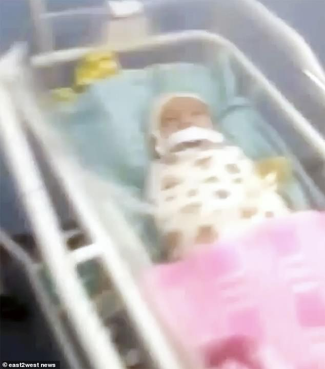 A hospital source said usually the mother is with the baby - who was born prematurely in September - almost round the clock