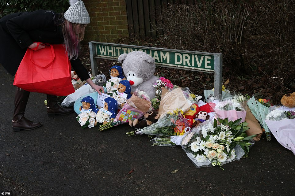 Locals have come from the town to place messages of condolence, flowers and teddy bears near the scene of the fire