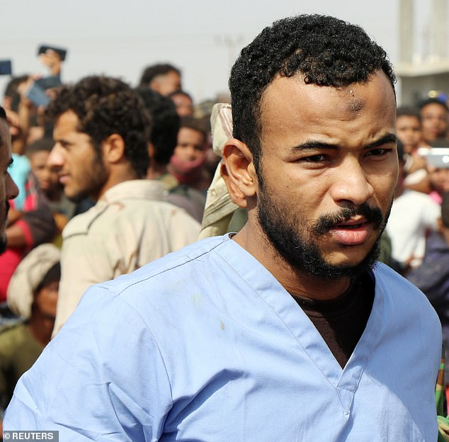 Face of a killer: Refat, 28, is seen in the final minutes before his public execution in Aden, Yemen, after he was convicted of the brutal kidnap, rape and murder of the boy