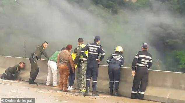 Emergency responders and community members are seen pleading with the depressed woman not to jump