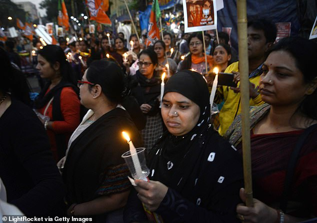 A teenager was gang-raped by six men as her father was forced to watch in the latest horrifying Indian sex attack (file photo showing activists protesting against rape in India)