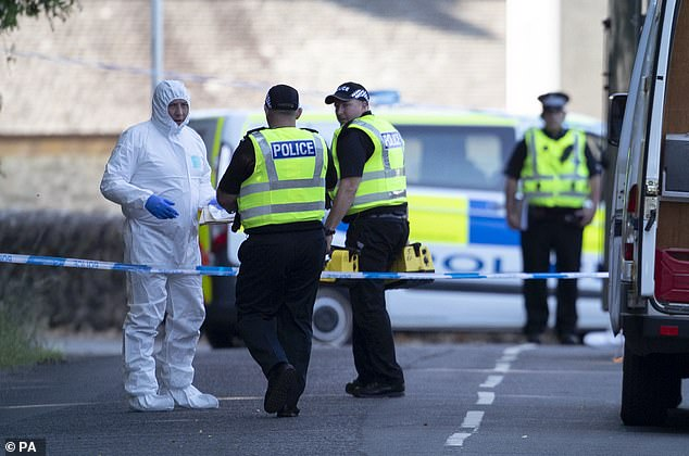 Forensic officers on the Isle of Bute in Scotland last July after officers discovered the body