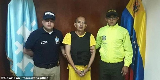 Juan Carlos Sanchez Latorre flanked by an Interpol agent and a Colombian police officer after his arrest and extradition back to Colombia