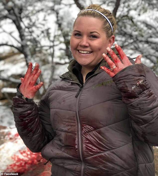 Caught red-handed:She shared this image with blood coating her hands and clothes