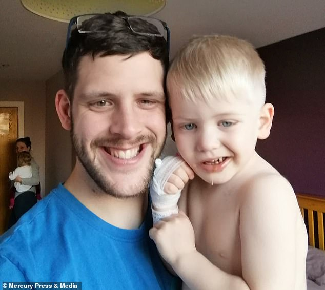 Wesley Lacey, 28 and his partner Rebecca Oldham, 29, noticed their son, Jack Lacey, was smiling on one side (pictured) but weren